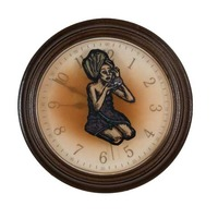 "<p><em>The Hours 4</em>, 2009, 9""diam. Ink, acrylic and polyurethan in clock. </p>"