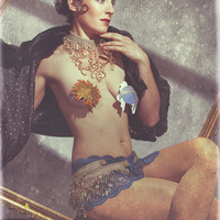 """<p>""""Celestial Chandelier"""" Crystal hipskirt and choker, sun and moon double layer pasties, feather fasinator and starry night faux fur shall: Katharine Leigh Simpson</p> <p>Model: LaGoosie Photography: Jesse Paulk Photography © 2012</p>"""